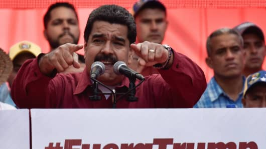 Venezuela's President Nicolas Maduro (C) gestures as he speaks during a rally supporting him and opposing U.S. President Donald Trump, in Caracas, on August 14, 2017.