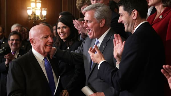 House Ways and Means Committee Chairman Rep. Kevin Brady (R-TX) is greeted by applause from (L-R) Rep. Kristi Noem (R-SD), House Majority Leader Rep. Kevin McCarthy (R-CA), and Speaker of the House Rep. Paul Ryan (R-WI) during an event at the Capitol to celebrate the passing of the tax reform bill November 16, 2017 in Washington, DC.