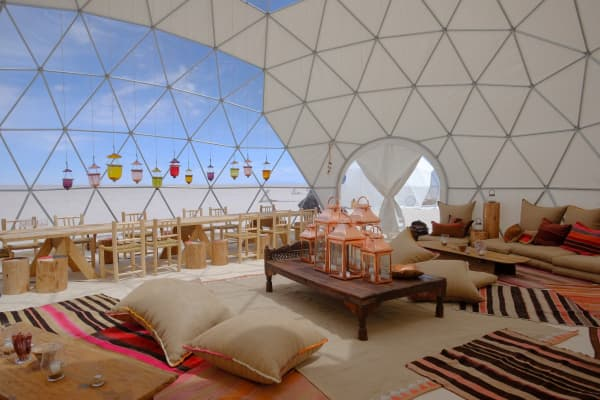 Dome tents with local furnishings on Uyuni salt flats in Bolivia