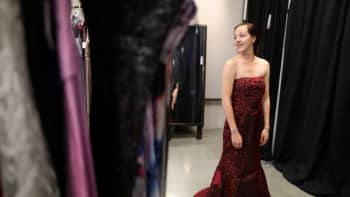 Alyssa Woods, 17, tries on a prom dress at the Operation School Bell Prom Day prom outfit giveaway for low-income and homeless students March 29, 2017