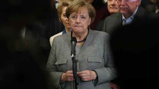 German Chancellor and leader of the German Christian Democrats (CDU) Angela Merkel, standing with leading members of her party, speaks to the media after preliminary coalition talks collapsed on November 19, 2017 in Berlin, Germany.