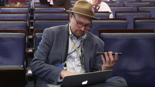 New York Times reporter Glenn Thrush works in the Brady Briefing Room after being excluded from a press gaggle by White House Press Secretary Sean Spicer, on February 24, 2017 in Washington, DC.