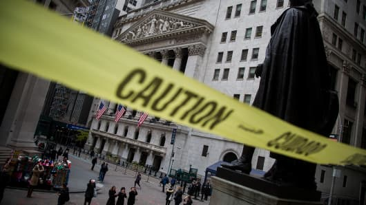 Caution tape hangs near the steps of Federal Hall across from the New York Stock Exchange in New York.