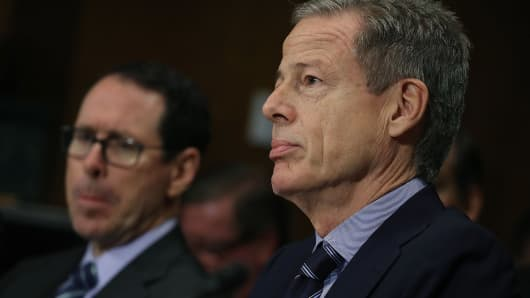 Time Warner CEO Jeffrey Bewkes (right), and AT&T CEO Randall Stephenson listen to testimony during a Senate Judiciary Subcommittee hearing on Capitol Hill, December 7, 2016, in Washington, DC. The subcommittee heard testimony regarding a proposed merger between AT&T and Time Warner.
