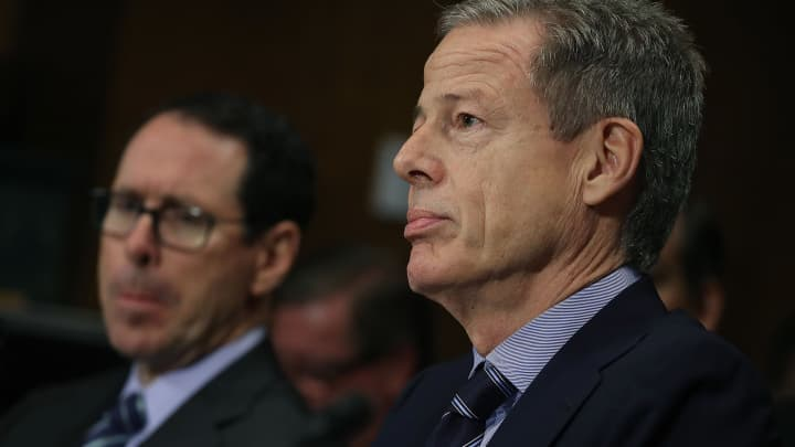 Jeffrey Bewkes, (R), CEO of Time Warner, and Randall Stephenson (L), CEO of AT&T, listen to testimony during a Senate Judiciary Subcommittee hearing on Capitol Hill, December 7, 2016 in Washington, DC. The subcommittee heard testimony regarding a proposed merger between AT&T and Time Warner.