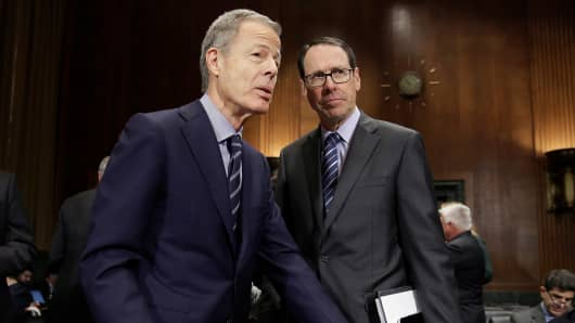 Chairman and Chief Executive Officer of Time Warner Jeffrey Bewkes (L) speaks with Chairman and Chief Executive Officer of AT&T Randall Stephenson before a Senate Judiciary Committee Antitrust Subcommittee hearing on the proposed deal between AT&T and Time Warner in Washington, U.S., December 7, 2016.