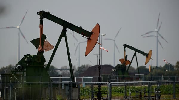 Pumpjacks pump petroleum from the ground on September 23, 2014 near Ruehlermoor, Germany.