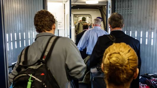 Passengers boarding a flight at John F. Kennedy International Airport.