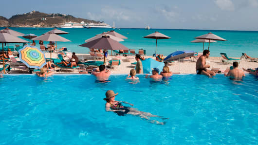 People relax in swimming pool at Great Bay Beach Resort, Philipsburg, St. Maarten, Netherlands Antilles, Caribbean.