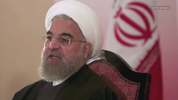 Iran President Hassan Rouhani declares the end of Islamic State