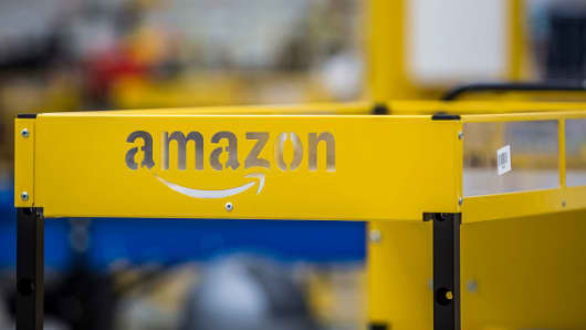 An Amazon logo sits on a collection cart for customer orders at the Amazon.Com fulfillment center in Dobroviz, Czech Republic, on Sept. 8, 2015.