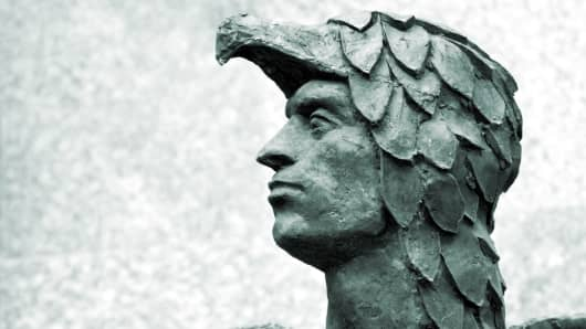 An antique sculpture of Icarus from Greek mythology.