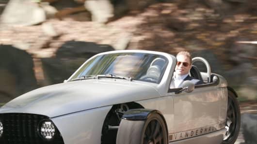 Robert Frank driving a Vanderhall Laguna