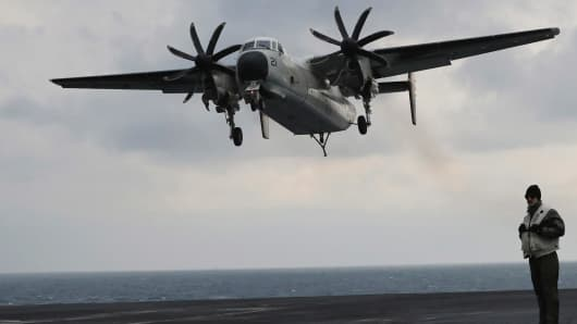 In this March 14, 2017, file photo, a U.S. Navy C-2 Greyhound approaches the deck of the Nimitz-class aircraft carrier USS Carl Vinson.