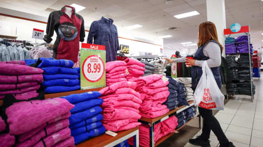 A shopper checks on merchandise at the J.C. Penney department store in North Riverside, Illinois.