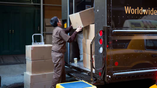 A United Parcel Service driver loads a truck with packages in the Soho neighborhood of New York.