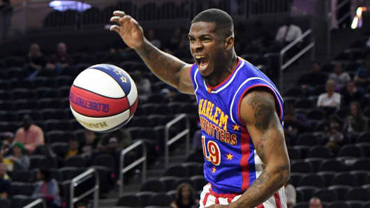 Saul 'Flip' White #19 of the Harlem Globetrotters reacts after dunking against the World All-Stars during their exhibition game at T-Mobile Arena on February 9, 2017 in Las Vegas, Nevada.