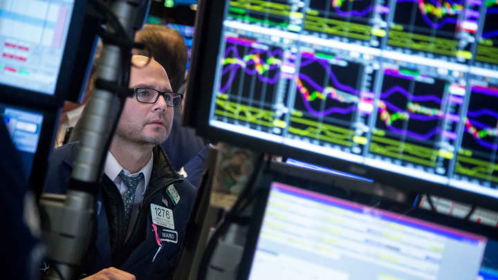 A trader works on the floor of the New York Stock Exchange in New York.