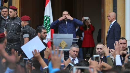 Lebanese prime minister Saad Hariri (L) greets his supporters upon his arrival at his home in Beirut on November 22, 2017. Hariri, back in Beirut after a mysterious odyssey that saw him announce his resignation in Saudi Arabia, told cheering supporters that he was staying.
