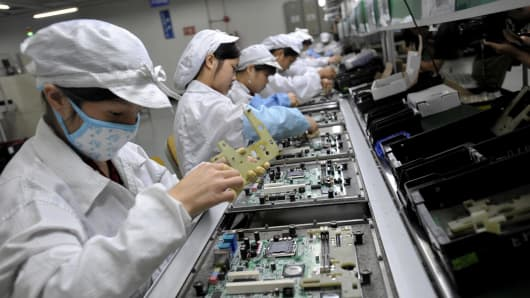 Chinese workers assemble electronic components at the Taiwanese technology giant Foxconn's factory in Shenzhen, China.