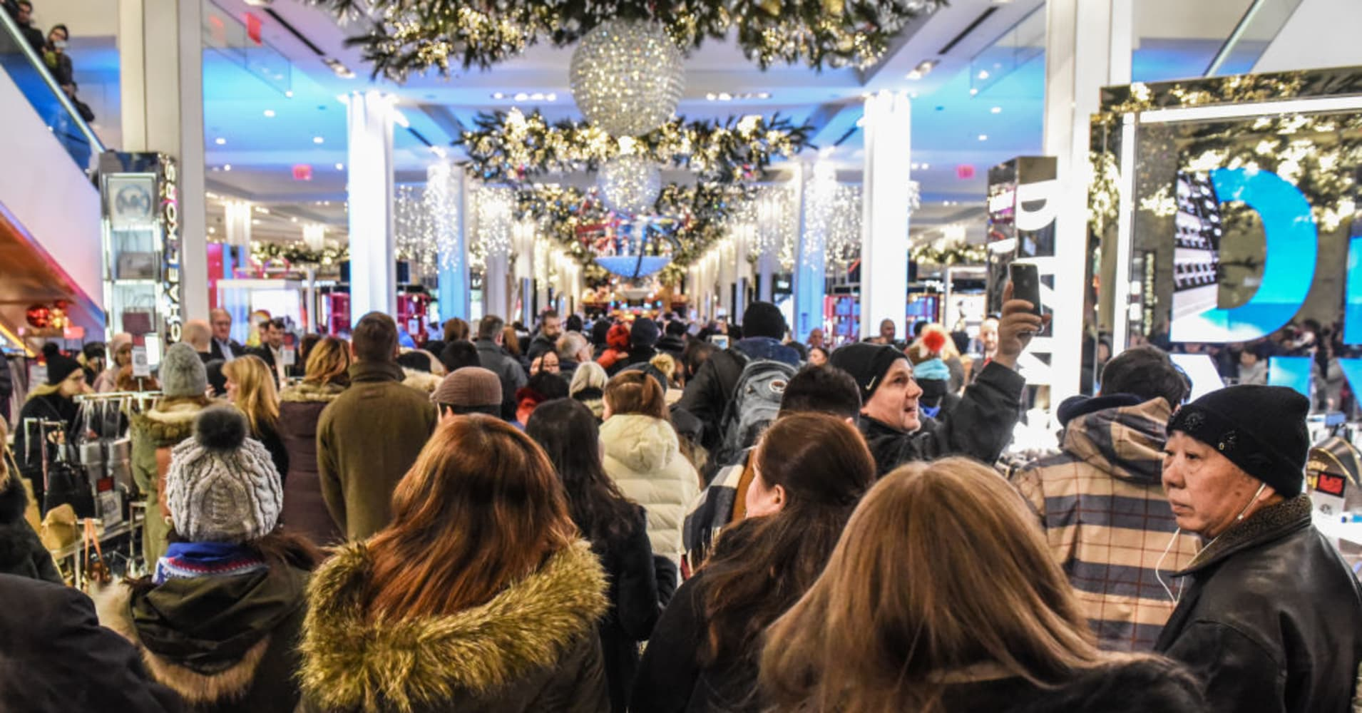 Shoppers enter Macy's department store on 'Black Friday' on November 23, 2017 in New York City.
