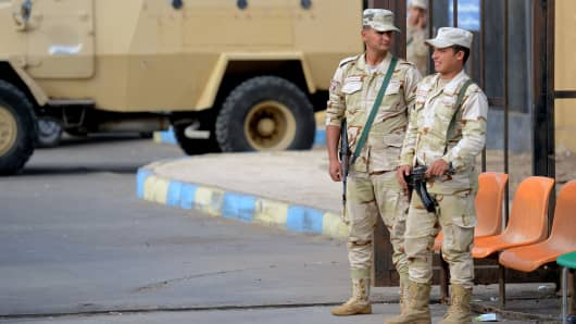 Egyptian army conscripts stand guard outside the Suez Canal University hospital in the eastern port city of Ismailia on November 25, 2017, where the victims of a bomb and gun assault on the North Sinai Rawda mosque that took place the day before are receiving treatment.