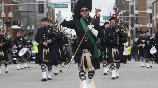 The Boston Police Pipes and Drums band marches during the St. Patrick's Day Parade in Boston on Mar. 19, 2017.