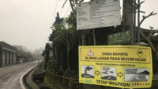A sign in Bali warns of lava and danger.