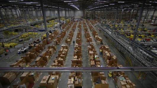 Parcels are prepared for dispatch at Amazon's warehouse in Hemel Hempstead, England.
