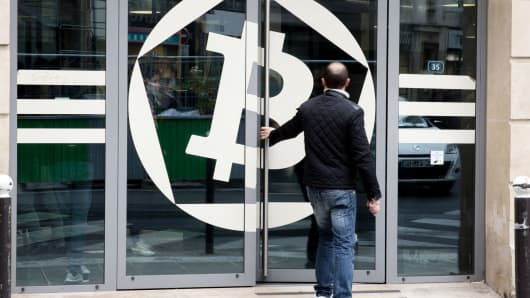 A customer enters the offices of La Maison du Bitcoin bank in Paris, France.