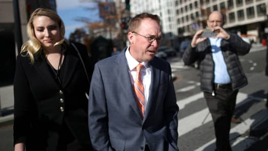 Mick Mulvaney leaves the Consumer Financial Protection Bureau (CFPB) building after a meeting in downtown Washington D.C., November 27, 2017.
