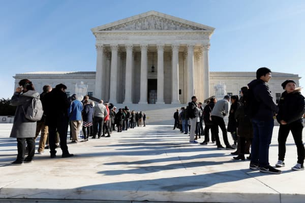 Visitors stand in line outside the Supreme Court in Washington, D.C.