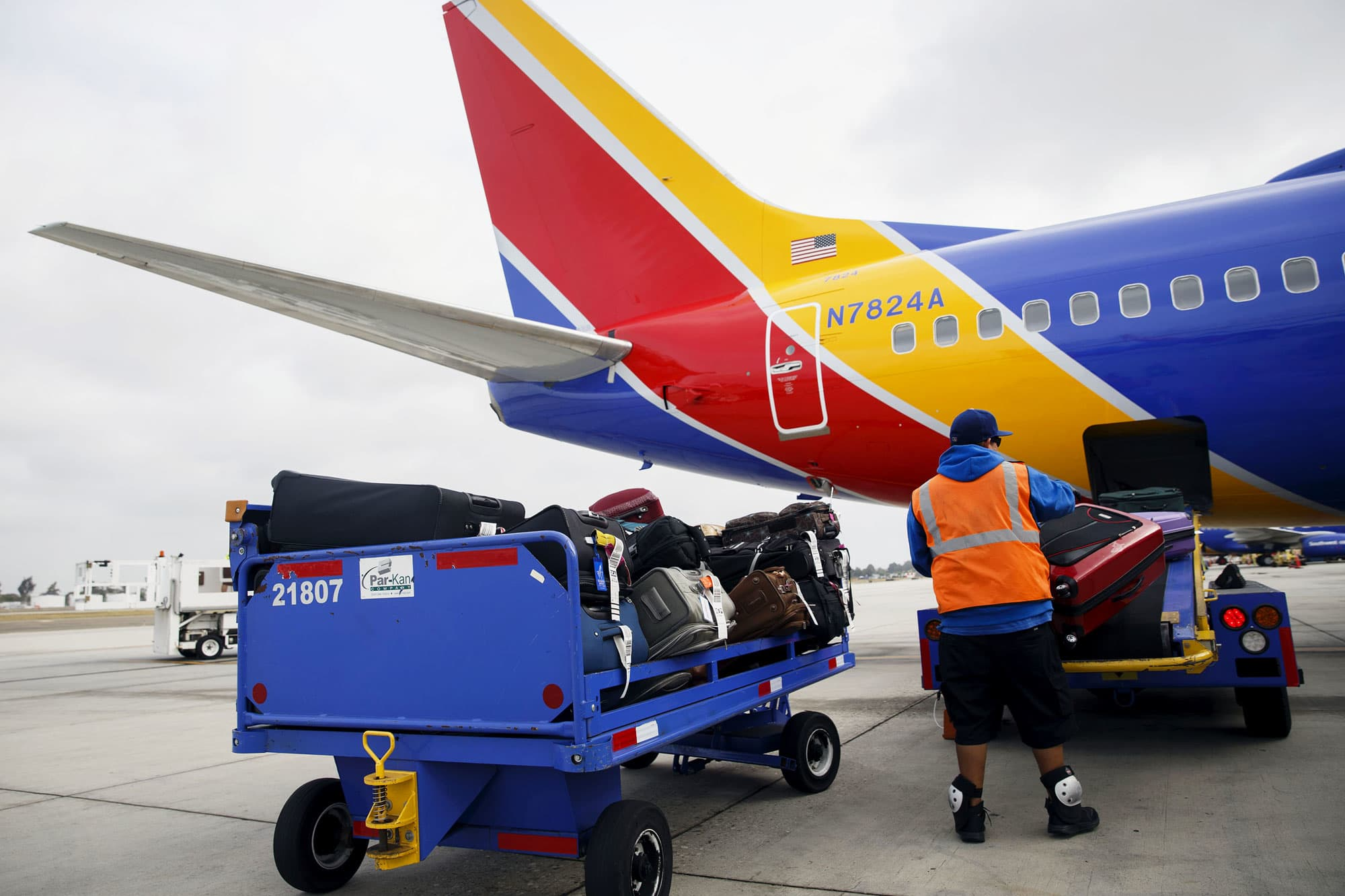 Southwest airlines wants larger boeing 737 max 8s soon a ground operations employee loads baggage onto a southwest airlines plane at john wayne airport in buycottarizona