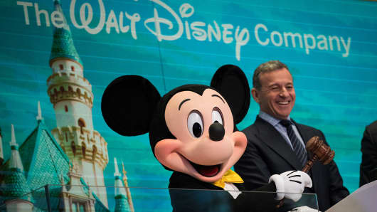 Mickey Mouse and chief executive officer and chairman of The Walt Disney Company Bob Iger prepare to ring the opening bell at the New York Stock Exchange (NYSE), November 27, 2017 in New York City.