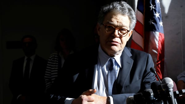 Senator Al Franken talks to the media outside his office on Capitol Hill in Washington, U.S., November 27, 2017.