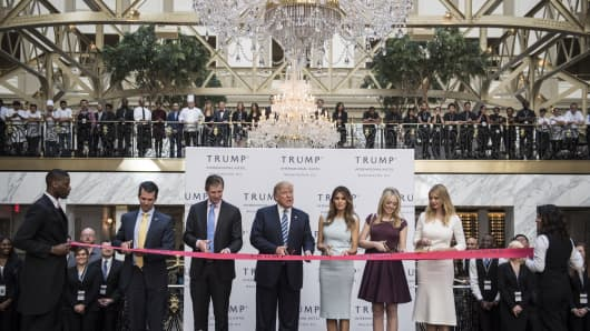 Then-Republican presidential candidate Donald Trump cuts a ribbon during the grand opening ceremony of the Trump International Hotel-Old Post Office in Washington, D.C. in October 2016. The hotel was able to use a tax credit for the rehabbing of historic buildings.