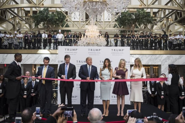 Then-Republican presidential candidate Donald Trump cuts a ribbon during the grand opening ceremony of the Trump International Hotel-Old Post Office in Washington, D.C. in October 2016. The hotel was able to use a tax credit for the rehabbing of historic buildings, which would disappear in the GOP tax plan at a time when many entrepreneurs are trying to revive Main Streets across the country.