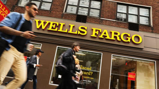 People go by a Wells Fargo bank branch on October 13, 2017 in New York City.