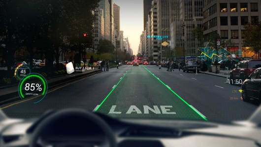 A view of the Navion augmented reality driving system projected onto a windshield.