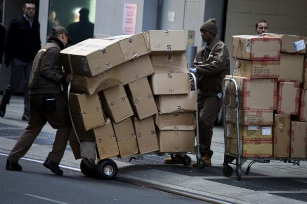 United Parcel Service Inc. (UPS) drivers deliver packages on Cyber Monday in New York.