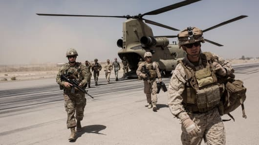 U.S. service members walk off a helicopter on the runway at Camp Bost on Sept. 11, 2017 in Helmand Province, Afghanistan.