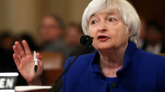 Federal Reserve leaves rates unchanged, sees inflation rising this year