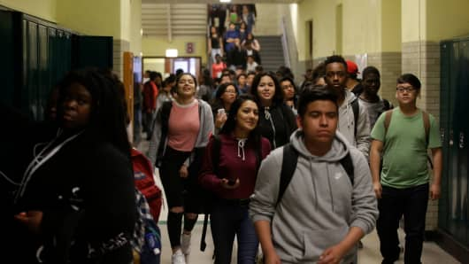 Students walk through the hallway after classes were dismissed at Senn High School on Wednesday, May 10, 2017 in Chicago, Illinois.