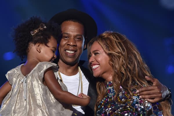 Blue Ivy Carter, recording artists Jay Z and Beyonce speak onstage during the 2014 MTV Video Music Awards.
