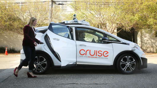 A woman gets in a self-driving Chevy Bolt EV car during a media event by Cruise, GM's autonomous car unit, in San Francisco, California, U.S. November 28, 2017.