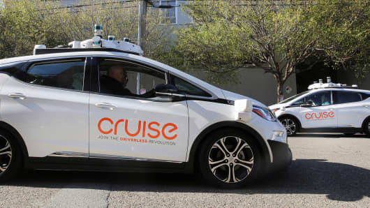 Two self-driving Chevy Bolt EV cars are seen during a media event by Cruise GM's autonomous car unit in San Francisco California