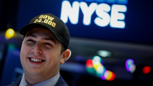 A trader wears a DOW 24,000 hat as he works on the floor of the New York Stock Exchange, (NYSE) as the Dow Jones Industrial Average crosses 24,000, in New York, U.S., November 30, 2017.