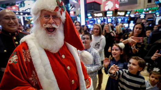 A man dressed as Santa Claus, walks on the floor during the traditional bring-your-kids-to-work day at the New York Stock Exchange (NYSE) in New York, U.S., November 24, 2017.
