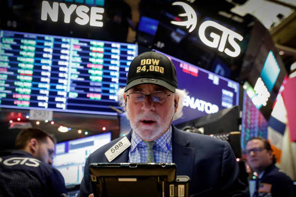 Trader Peter Tuchman works on the floor of the New York Stock Exchange, (NYSE) as the Dow Jones Industrial Average crosses 24,000, in New York, U.S., November 30, 2017.