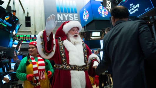 A man dressed as Santa Claus visits the floor of the New York Stock Exchange (NYSE) ahead of the closing bell, November 30, 2017 in New York City. On Thursday afternoon, the Dow closed at over 24,000 points for the first time in its history. (Drew Angerer/Getty Images)